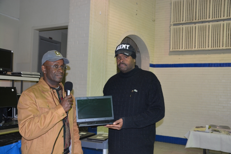 Army Veteran receiving laptop computer